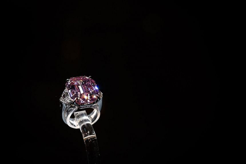 The Pink Legacy, weighing just under 19 carats, was once owned by the Oppenheimer family, who built De Beers into the world's biggest diamond trader.