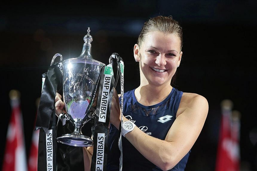 Agnieszka Radwanska, seen with the 2015 WTA Finals Singapore Cup, reached a career-high ranking of second in 2012 and finished in the top-10 rankings for six consecutive seasons from 2011-16.