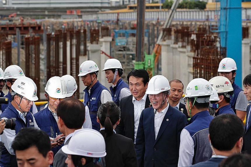 South Korean President Moon Jae-in (centre, with helmet) visiting the East Coast integrated depot worksite yesterday.