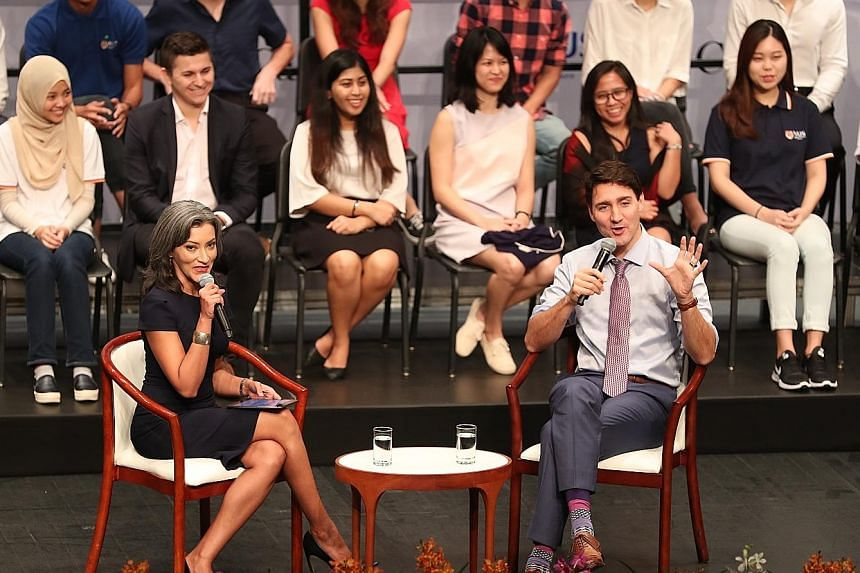Canadian Prime Minister Justin Trudeau and BBC presenter Sharanjit Leyl at a dialogue at the National University of Singapore yesterday. Mr Trudeau said it was a careful balancing act engaging countries on human rights issues while building a working