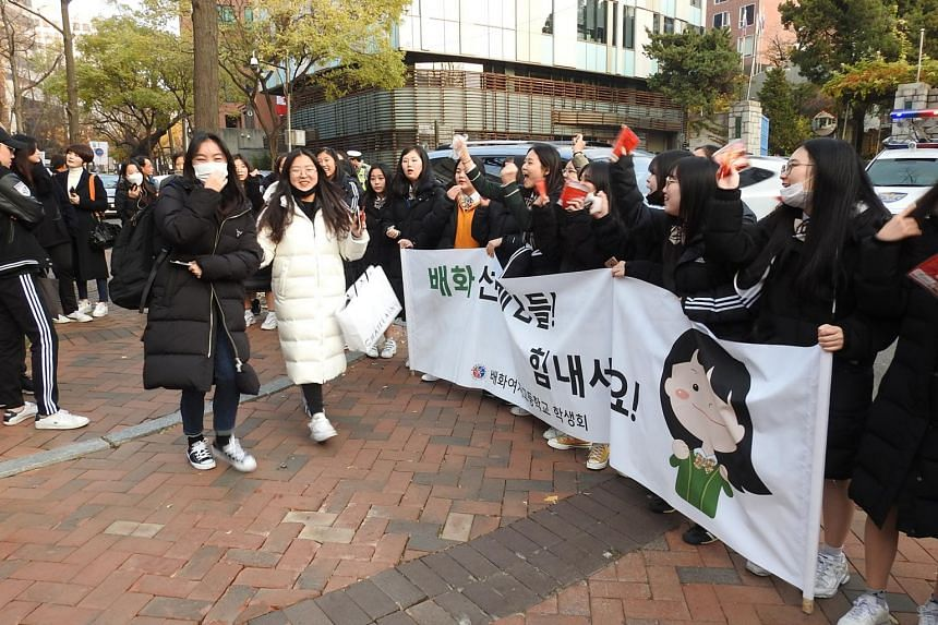 Dozens of high school students gathered outside Ewha Girls' High School in Seoul holding banners and placards to cheer for their seniors taking the national university entrance exam on Nov 15, 2018. The banner reads: Seniors, give it your all!