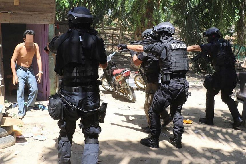 Malaysia's Special Branch's Counter Terrorism Division arresting one of the terror suspects in Sabah.