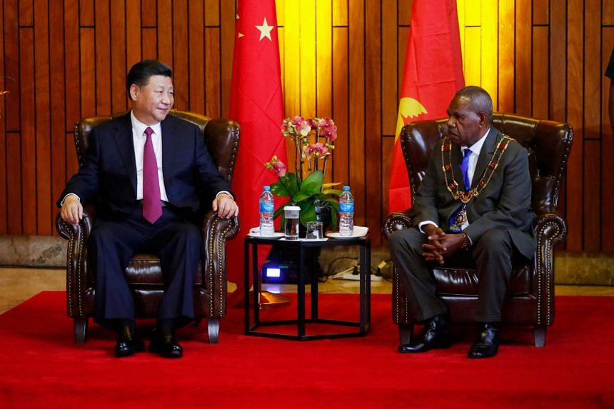 China's President Xi Jinping (left) meets with Papua New Guinea's Governor-General Bob Dadae during a state visit at Parliament House in Port Moresby, on Nov 16, 2018.
