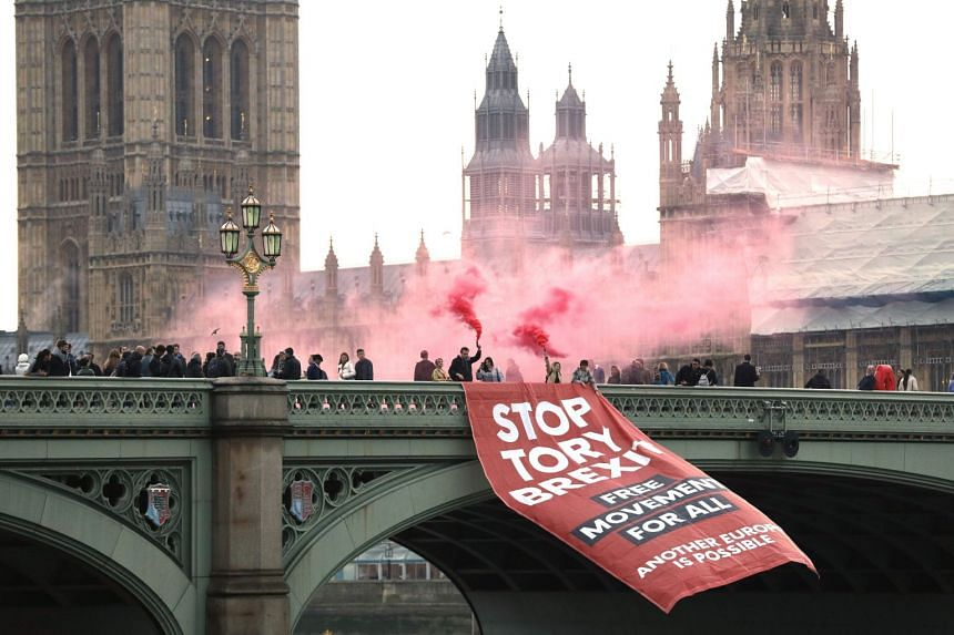 Anti-Brexit campaigners unfurl a banner in front of the Houses of Parliament in London, Nov 15, 2018..