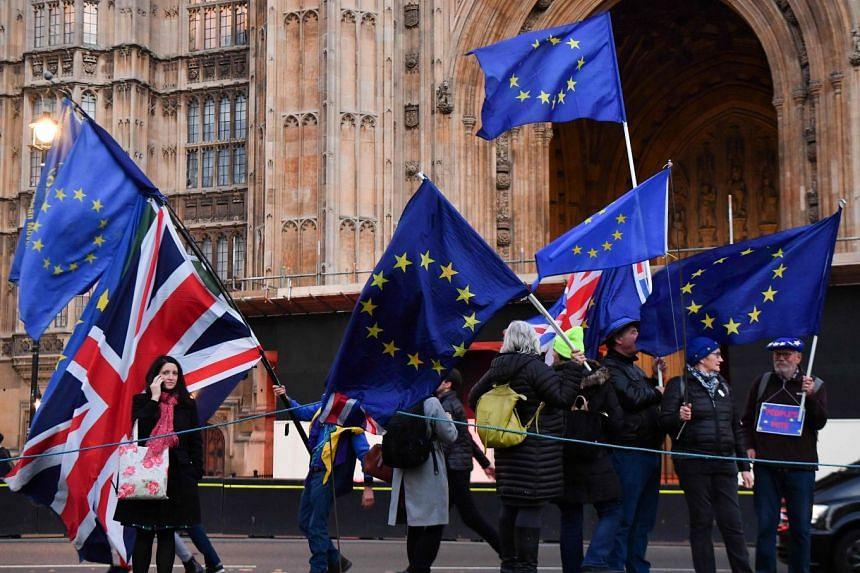 Anti-Brexit campaigners with EU and Union Flags seen near the Houses of Parliament in central London on Nov 15, 2018.