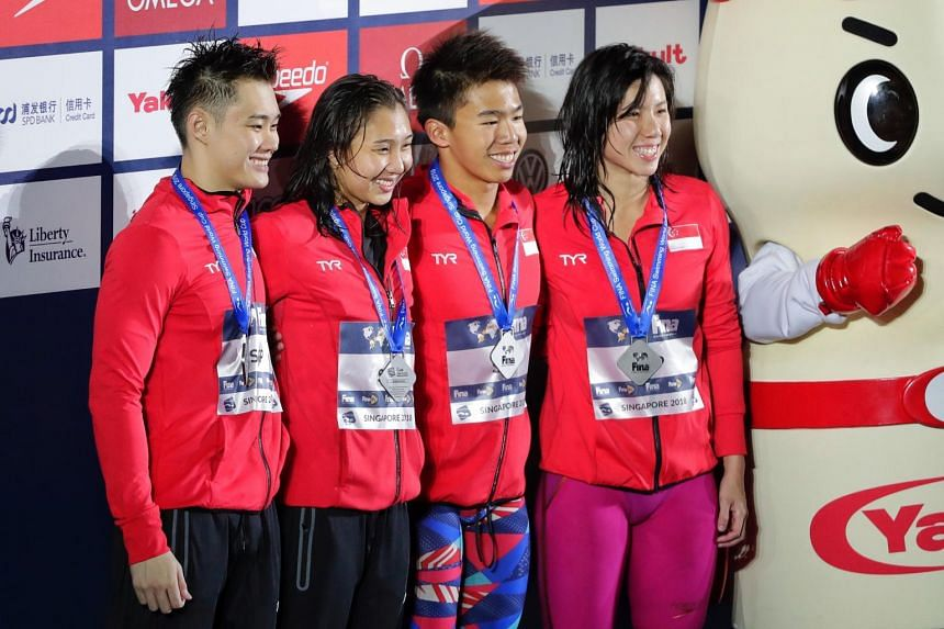 (From left) Teong Tzen Wei, Marina Chan, Jonathan Tan and Amanda Lim clocked 1min 33.14 sec to finish second in the mixed 4x50m freestyle relay at the Fina Swimming World Cup on Nov 16, 2018.
