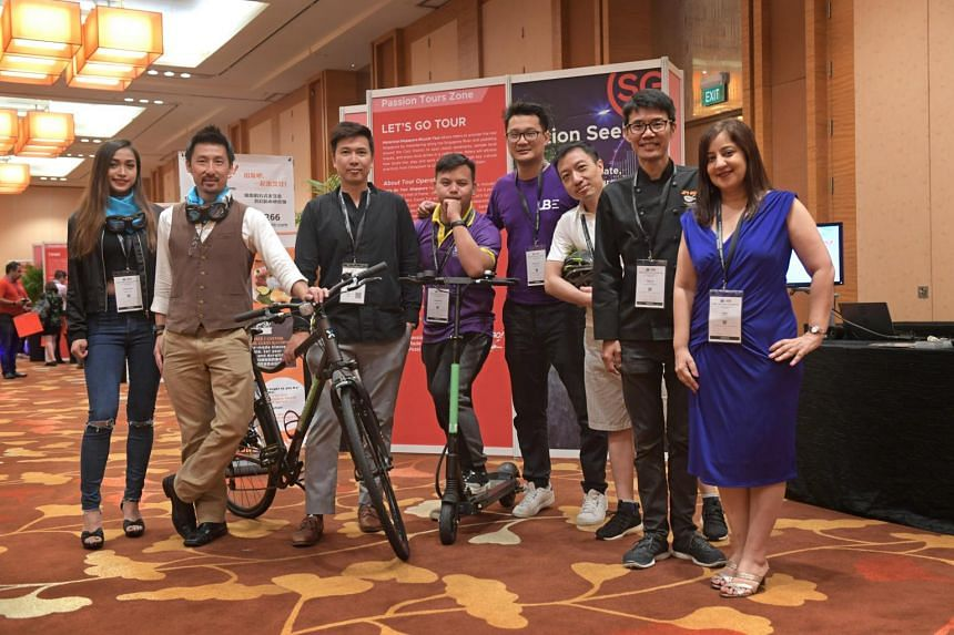 Members of the newly formed Tour Operators Alliance: (from left) Ms Joy Ng, reservation agent at Singapore Sidecars; Mr Simon Wong, co-founder of Singapore Sidecars; Mr Jason Loe, co-founder of Tribe; Mr Kyanta Hidayat, resident guide at Monster Day