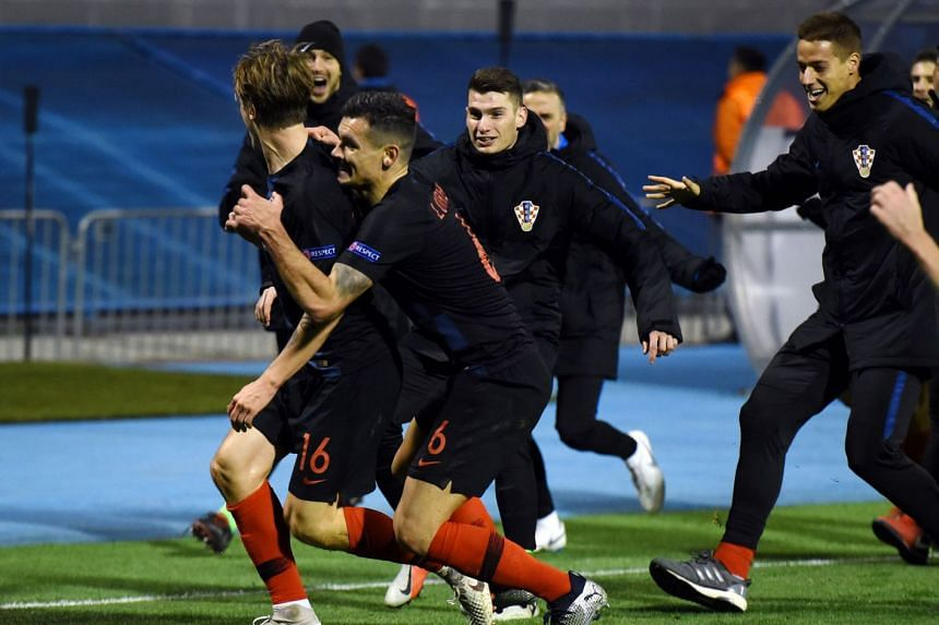 Croatia's Tin Jedvaj celebrates with team mates after scoring.