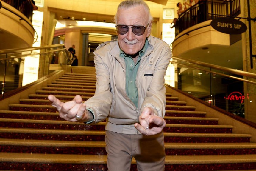 Stan Lee strikes a Spider-Man pose during a movie premiere in 2015.
