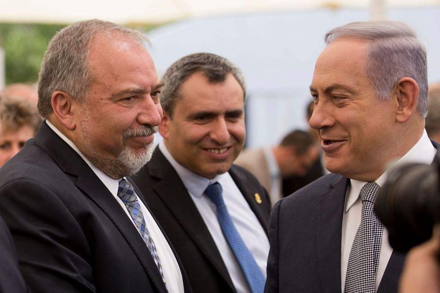 Avigdor Lieberman (left) and Benjamin Netanyahu (right) attending a Cabinet meeting in 2016.