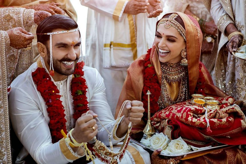 Deepika Padukone (right) and Ranveer Singh celebrate their wedding at Italy's Lake Como.