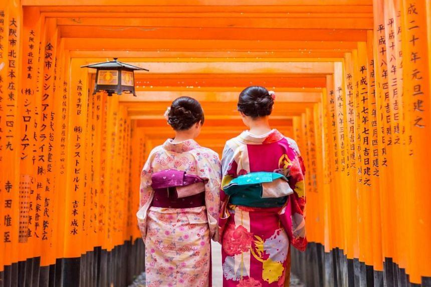 Enjoy a kimono-wearing experience at the Fushima Inari Shrine in Kyoto, Japan. PHOTO: CHAN BROTHERS TRAVEL