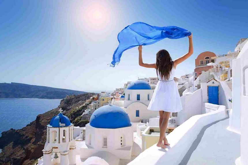 Take in the beauty of the Aegean Sea in Santorini, Greece. PHOTO: CHAN BROTHERS TRAVEL