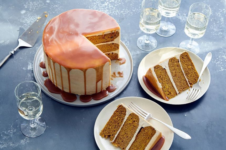 Pumpkin layer cake with caramel buttercream. This layer cake serves as a sweet alternative to the traditional Thanksgiving pumpkin pie.