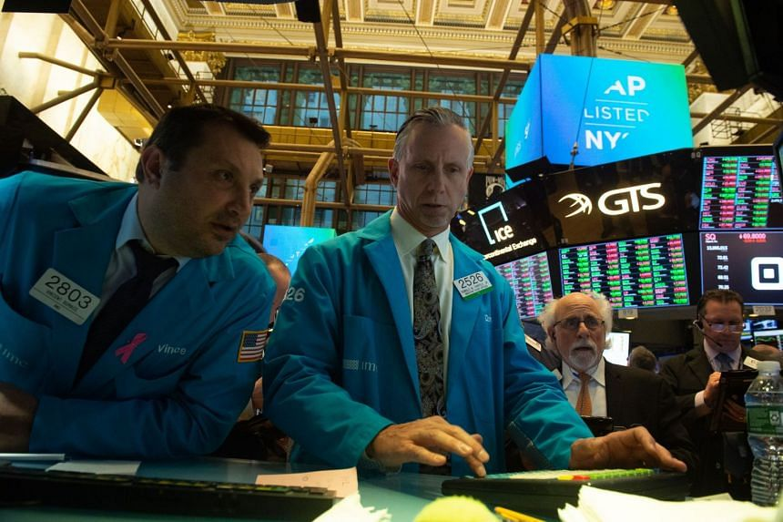 Traders work on the floor at the New York Stock Exchange on Nov 14, 2018.