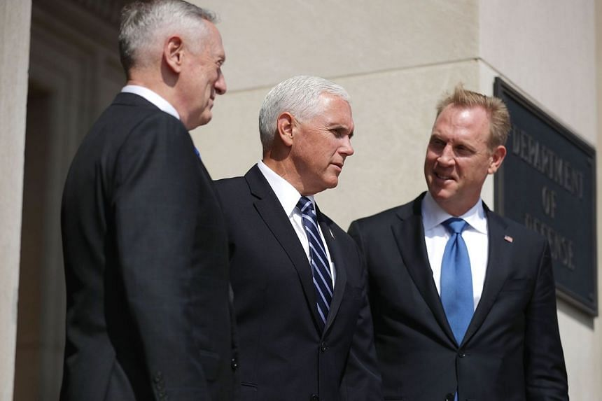 Shanahan (far right) at the Pentagon with US Defence Secretary James Mattis (left) and Vice-President Mike Pence.