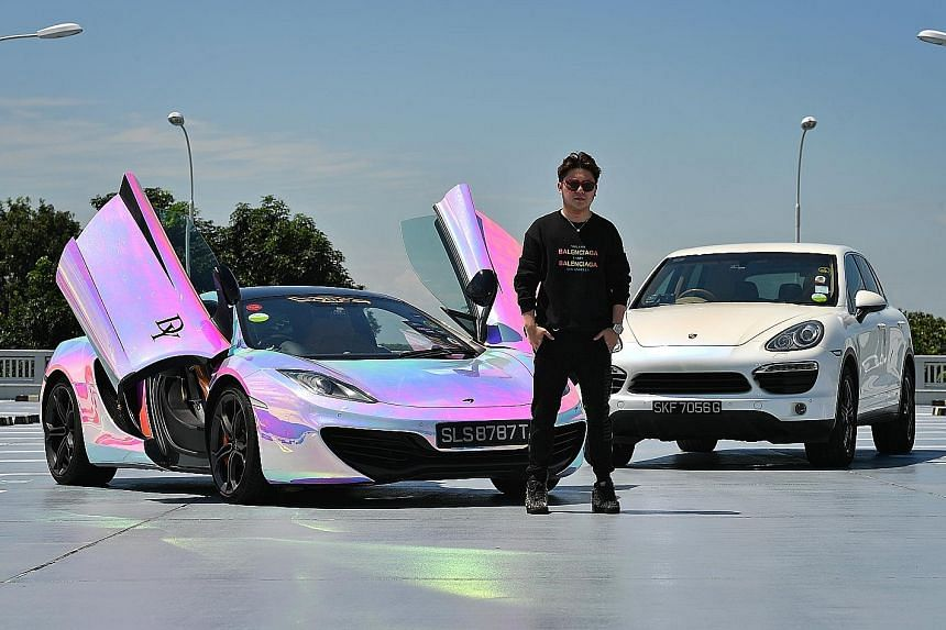 Mr David Yong paid about $500,000 for the McLaren MP4-12C coupe (left), which he drives mostly on weekends. He drives the Porsche Cayenne (right) daily.