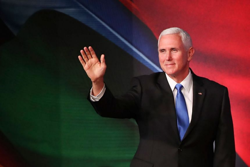US Vice-President Mike Pence waves as he arrives for the Apec Summit in Port Moresby, Papua New Guinea on Nov 17, 2018.