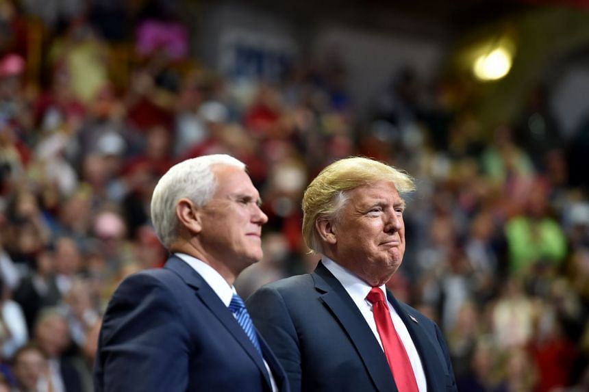 US Vice-President Mike Pence said he and President Donald Trump laughed about the suggestion of a rift in a phone call.