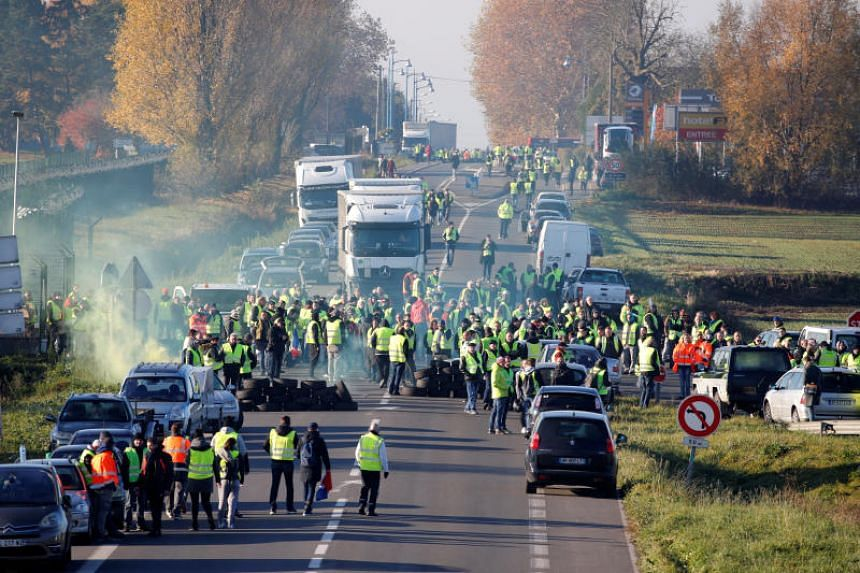 """The demonstrators are trying to block motorways as well as access to fuel depots in a grassroots movement dubbed the """"yellow vests"""" that began as a backlash against the higher fuel taxes introduced by French President Emmanuel Macron."""