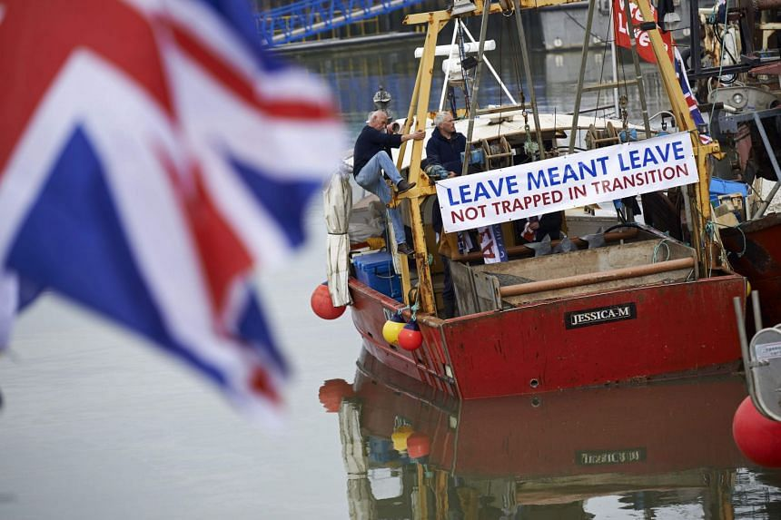 A boat prepares to depart during a demonstration in Whitstable, south-east England, on April 8, 2018, against the Brexit transition deal that would see Britain continue to adhere to the common fisheries policy after formally leaving the EU.