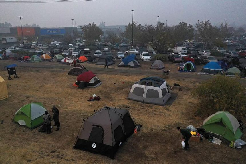Tents are seen pitched in a field next to a Walmart parking lot where Camp Fire evacuees have been staying, on Nov 16, 2018.