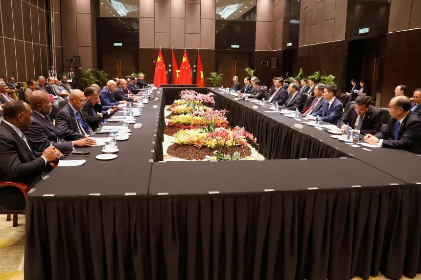 Papua New Guinea's Prime Minister Peter O'Neill talks with China's President Xi Jinping during a meeting in Port Moresby, on Nov 16, 2018.