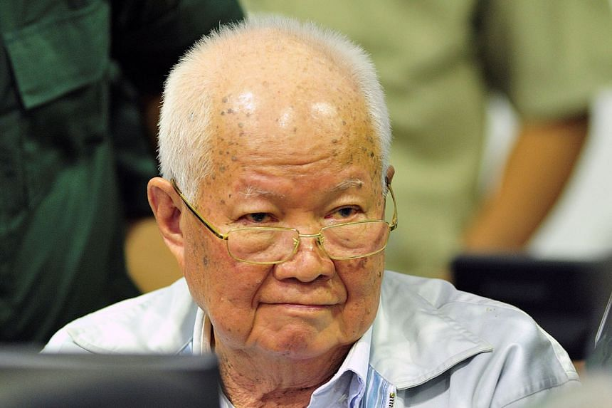 Nuon Chea (top) and Khieu Samphan (above) have been found responsible for genocidal actions by a UN-backed tribunal (left) which released its decision yesterday.