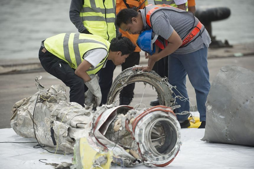 Investigators examining engine parts from the ill-fated Lion Air Flight JT610 at a port in Jakarta earlier this month.