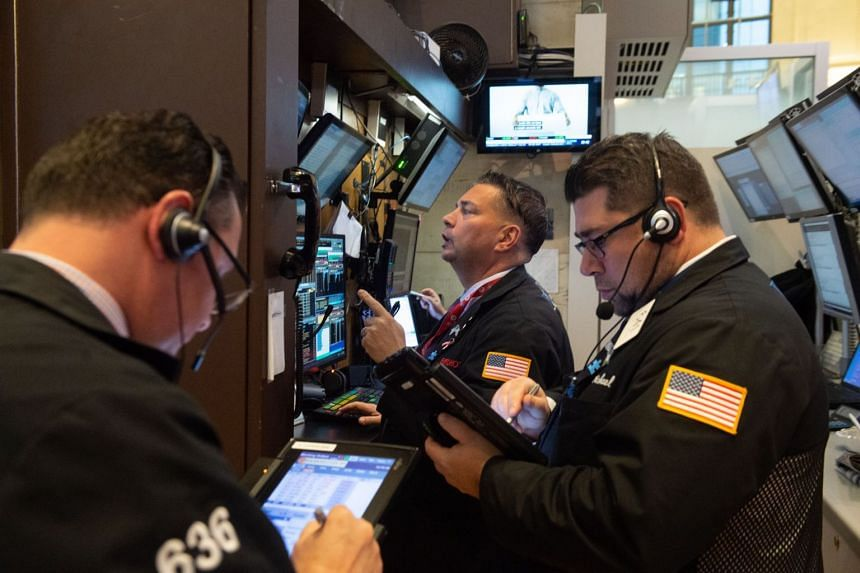 Traders work on the floor of the New York Stock Exchange on Nov 14, 2018.