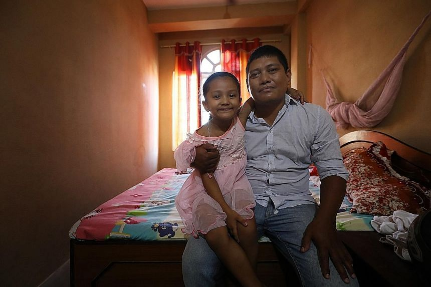 Hotel receptionist Dambar Jung Rana's daughter, Aaradhya, five, was warded in hospital two years ago for dengue fever. His 57-year-old father (not in photo) was infected as well. During that outbreak, nearly every household had one member come down w