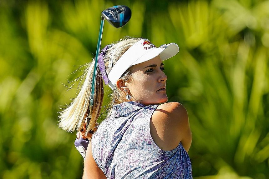 Lexi Thompson teeing off on the 15th hole during the second round of the LPGA Tour Championship in Naples, Florida. She carded a 67 for a 132 total and a three-shot lead.