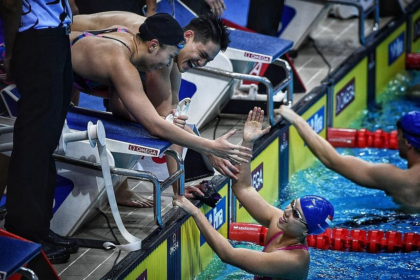 Schooling combined with Roanne Ho, Amanda Lim (in pool) and Teong Tzen Wei (not pictured) to win the medley relay silver in 1min 42.21sec, behind Australia in 1:39.69.