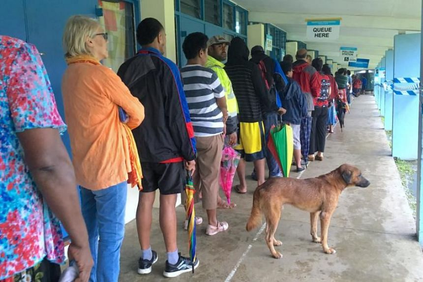 Voters wait in a line to enter a polling venue during voting for Fiji's general election near Suva, Fiji, on Nov 14, 2018.