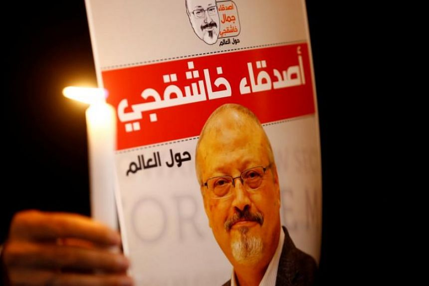 A demonstrator holds a poster with a picture of Saudi journalist Jamal Khashoggi outside the Saudi Arabia consulate in Istanbul, on Oct 25, 2018.