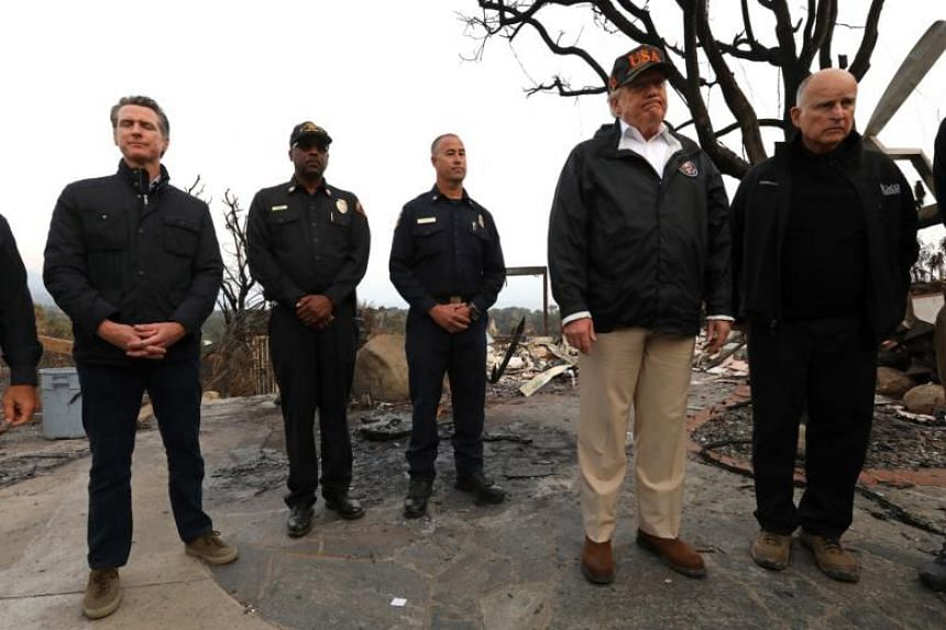 US President Donald Trump (second, right) toured the scene of devastation in Paradise, California, on Nov 17, 2018.