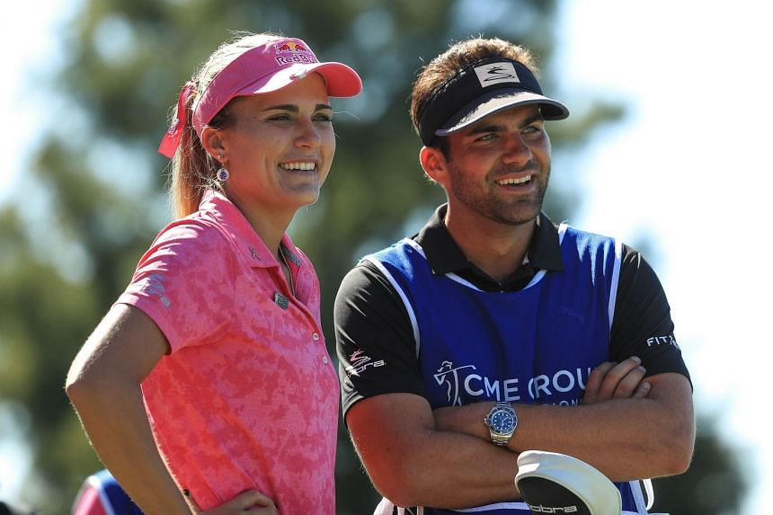 Lexi Thompson talking with her caddie, brother Curtis, on the fourth tee during the third round of the LPGA CME Group Tour Championship at Tiburon Golf Club on Nov 17, 2018 in Naples, Florida. She has a three-shot lead.