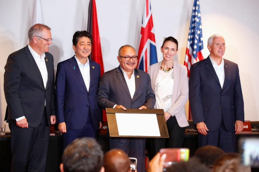 (From left) Australian Prime Minister Scott Morrison, Papua New Guinea Prime Minister Peter O' Neill, New Zealand Prime Minister Jacinda Ardern, Japanese Prime Minister Shinzo Abe and US Vice-President Mike Pence at the signing of the joint electrici