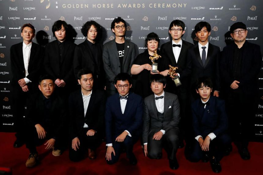 Cast members of An Elephant Sitting Still posing with the mother of late director Hu Bo (back row, centre), at the 55th Golden Horse Awards in Taipei on Nov 17, 2018.