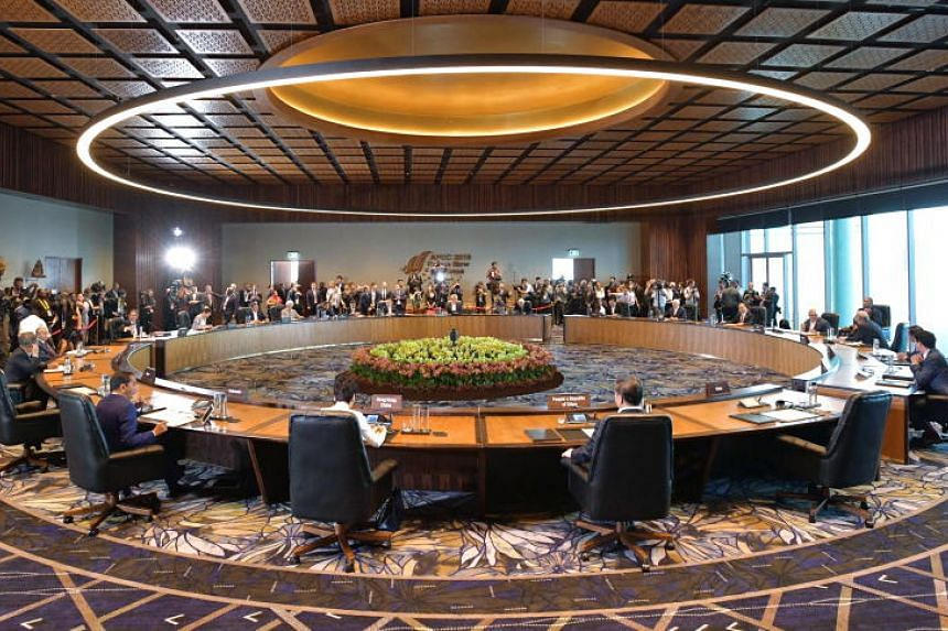 Leaders and delegates at the Apec Summit meeting during the retreat at the Apec Haus in Port Moresby, Papua New Guinea, on Nov 18, 2018.