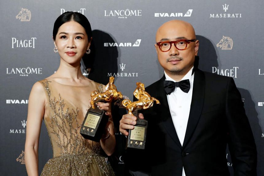 Actors Hsieh Ying-xuan (left) and Xu Zheng posing after winning the Best Leading Actress and Best Leading Actor awards respectively, at the 55th Golden Horse Awards.