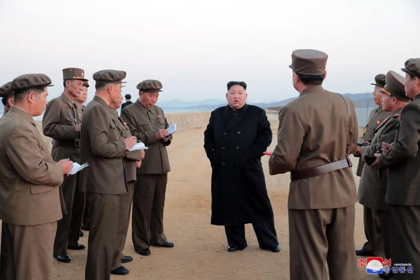 North Korean leader Kim Jong Un (centre) inspecting the test ground of the Academy of Defence Science in North Korea, in an image released on Nov 16, 2018.
