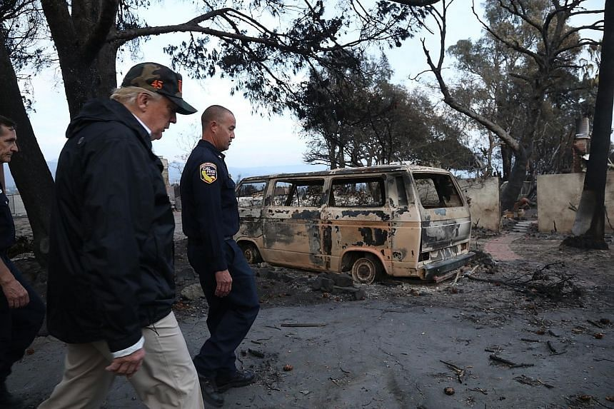 United States President Donald Trump touring a neighbourhood in Malibu, California, that was damaged by the Woolsey Fire.