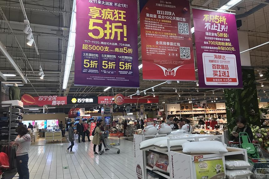 RT-Mart in Shanghai held promotions on Singles' Day to lure shoppers to buy from the physical store, as well as go online for bigger discounts.