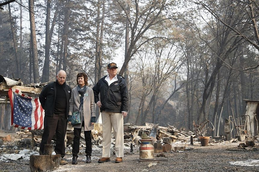 President Donald Trump visiting the fire-ravaged town of Paradise on Saturday, accompanied by California Governor Jerry Brown (left) and Paradise Mayor Jody Jones. Up to 10cm of rain is expected to fall from late tomorrow through Friday in the Sierra