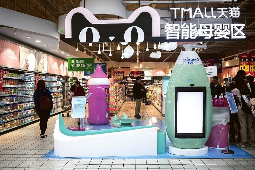 "The baby products section of an RT-Mart hypermarket, backed by Alibaba, in Shanghai. Alibaba has applied the ""new retail"" concept to some 400 brick-and-mortar stores in Chinese cities."