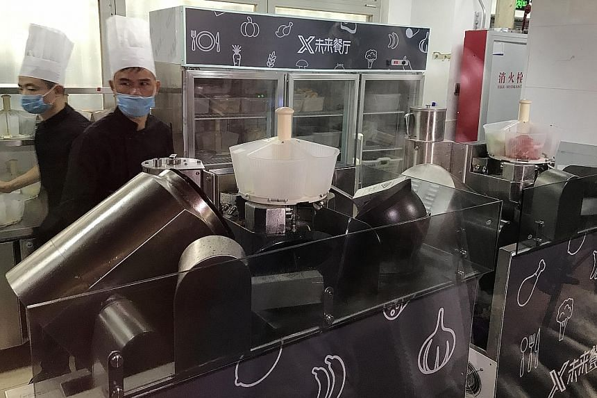 At the Future Restaurant, five robot cooks can whip up 40 pre-programmed Sichuan and Cantonese dishes. Human kitchen staff cut and prepare ingredients for the robots.