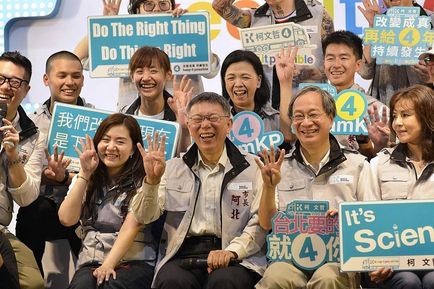 Taipei Mayor Ko Wen-je (centre) posing for a group photo at a campaign event with grassroots supporters in Taipei on Nov 7.