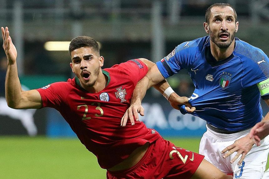 Portugal's Andre Silva and Italy's Giorgio Chiellini in a tussle for the ball during their Nations League Group 3 match in Milan on Saturday.