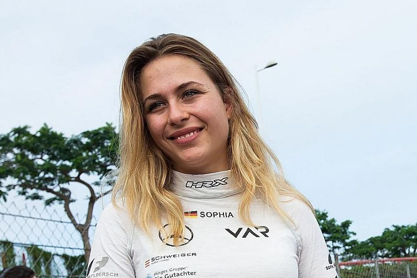 Race personnel and pit crew extricating German driver Sophia Florsch after she flew over the barriers and crashed into a photographers' bunker at high speed during the Formula Three race at yesterday's Macau Grand Prix. The 17-year-old will undergo s